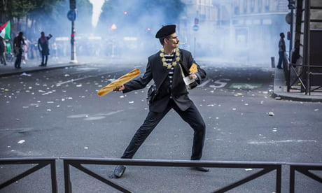 This French protestor in a suit